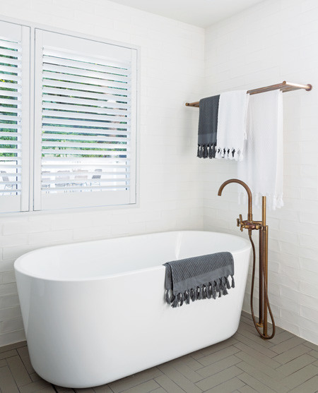 """""""With a young family and dogs, a bathtub is a necessity. The hand-held is the perfect tapware accessory."""""""