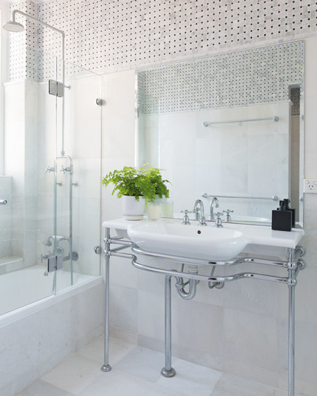 """The existing bath and basin were resurfaced, giving new life to the space without the hassle and expense of waterproofing and retiling."""