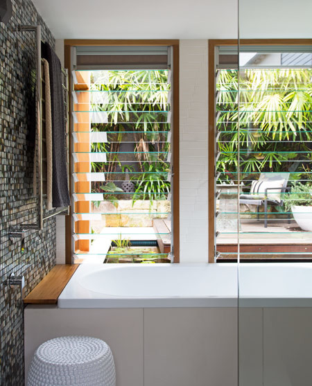 """""""The water level in the bath, when filled, is in line with the pond outside the window."""""""